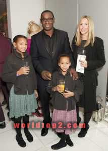 Kirsty Handy with her daughters and husband